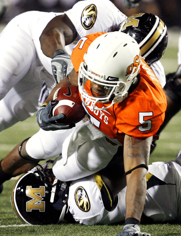 Photo - Keith Toston gets a first down during the college football game between Oklahoma State University (OSU) and the University of Missouri (MU) at Boone Pickens Stadium in Stillwater, Okla. Saturday, Oct. 17, 2009.  Photo by Steve Sisney, The Oklahoman
