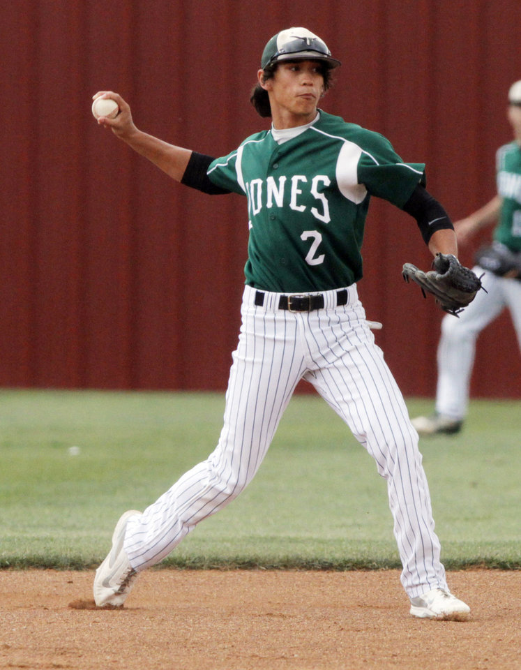 Photo - Jones short stop Keone Givens (2) throws to first base during a Class 3A baseball state game between Jones and Kansas at Edmond Memorial High School, Thursday, May 15, 2014, in Edmond. Photo by KT King, For The Oklahoman