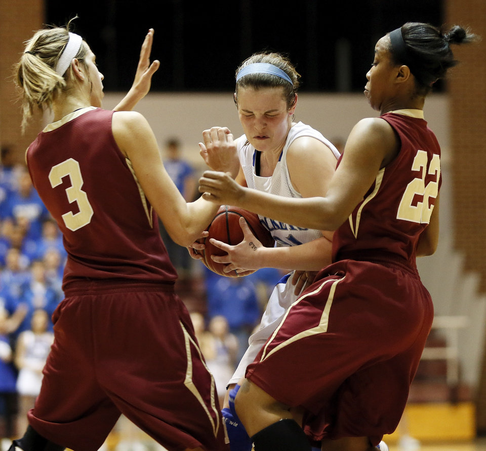 Mount St. Mary's Kaely Bond (21) gets caught between Byng's Alexis Hill (3) and Mackenzie Hudson (22) during a Class 4A girls high school basketball game in the first round of the state tournament at the Sawyer Center on the campus of Southern Nazarene University in Bethany, Okla., Thursday, March 7, 2013. Photo by Nate Billings, The Oklahoman