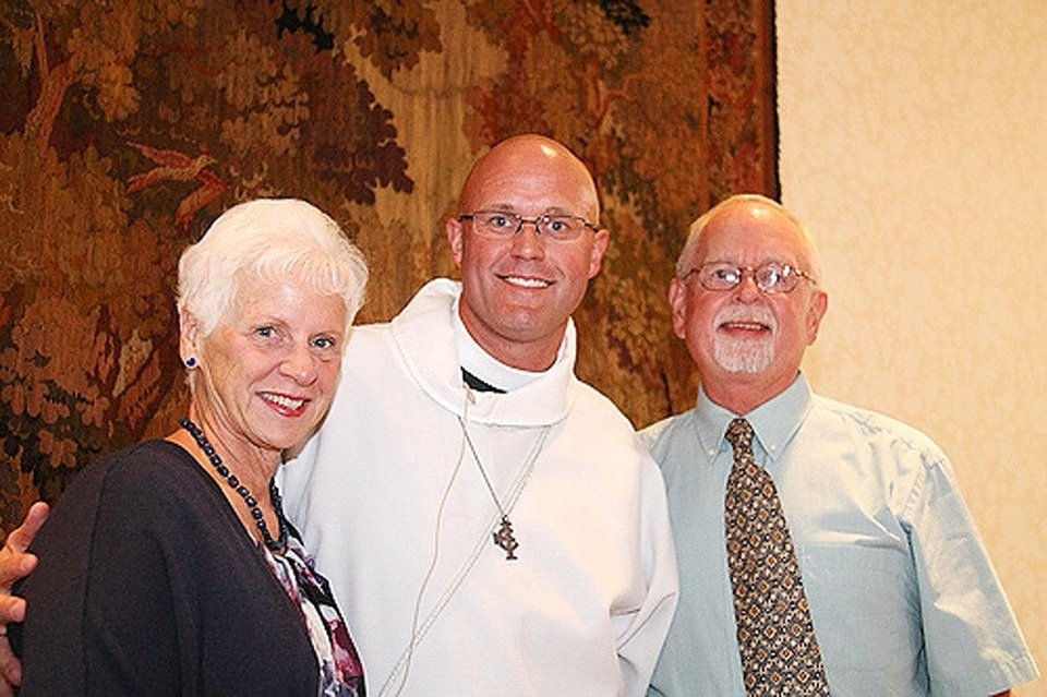 Photo - Above: The Rev. Justin Lindstrom, center, is with his parents, Jeanne and Joel Lindstrom, of Houston, on the day he preached his first sermon as the dean of St. Paul's Episcopal Cathedral in Oklahoma City.
