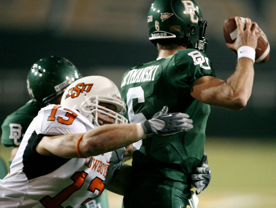 Nelson Peterson (13) sacks quarterback Blake Szymanski in the first half during the college football game between Oklahoma State University and Baylor University at Floyd Casey Stadium in Waco, Texas, Saturday, Nov. 17, 2007. BY STEVE SISNEY, THE OKLAHOMAN