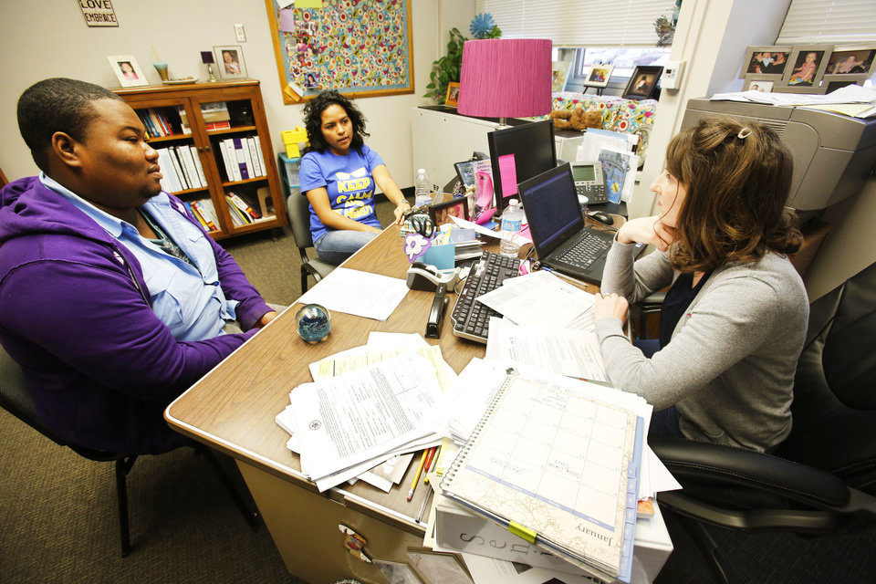 Northwest Classen seniors DeShawn Holliday, left, and Gabriella Rowles talk Thursday with school  counselor Ashley Westerman.  Photo by Steve Gooch, The Oklahoman