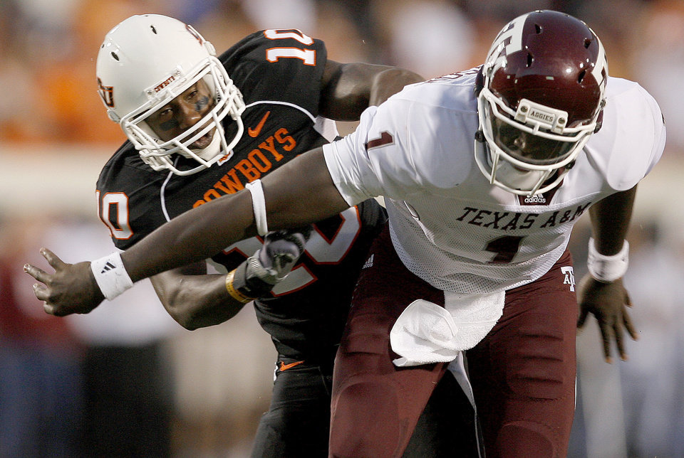 Photo - OSU's Markelle Martin puts pressure on Texas A&M's Jerrod Johnson during the college football game between Texas A&M University and Oklahoma State University (OSU) at Boone Pickens Stadium in Stillwater, Okla., Thursday, Sept. 30, 2010. Photo by Bryan Terry, The Oklahoman