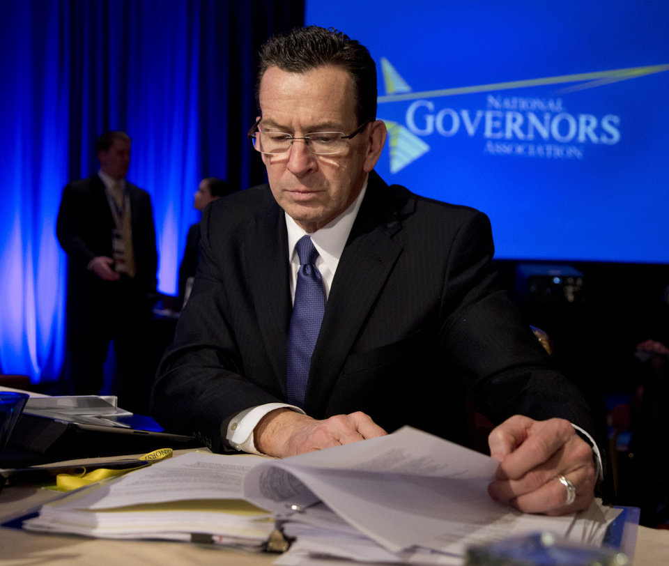 "Connecticut Gov. Dan Malloy reads documents before a Health and Homeland Security Committee meeting titled ""Protecting Our Nation: States and Cybersecurity"" during the National Governors Association 2013 Winter Meeting in Washington on Saturday, Feb. 23, 2013. (AP Photo/Manuel Balce Ceneta)"