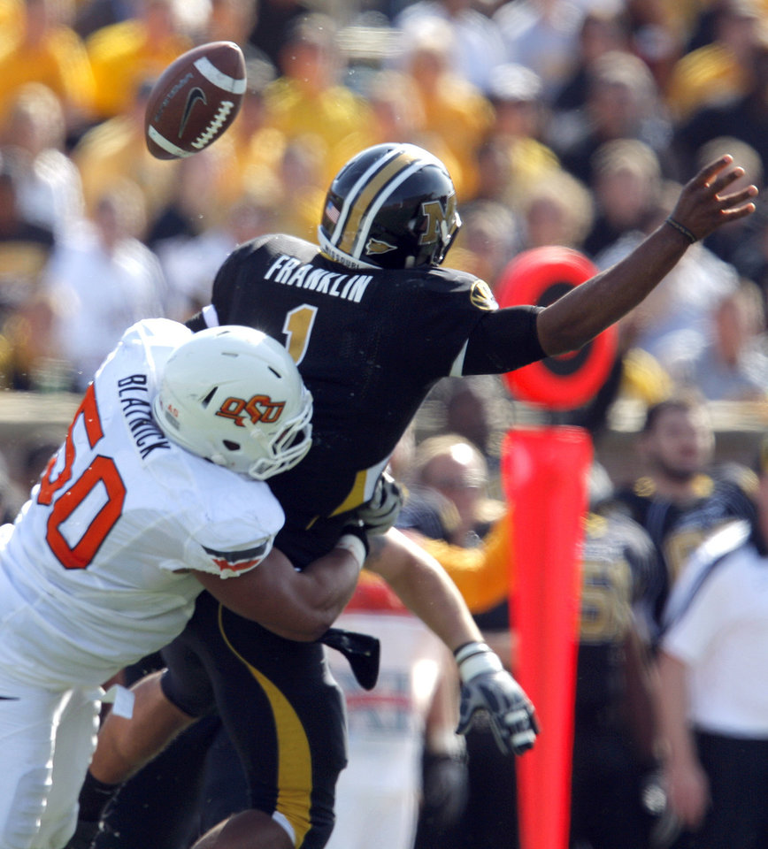 Photo - Oklahoma State's Jamie Blatnick (50) sacks Missouri's James Franklin (1)during a college football game between the Oklahoma State University Cowboys (OSU) and the University of Missouri Tigers (Mizzou) at Faurot Field in Columbia, Mo., Saturday, Oct. 22, 2011. Photo by Sarah Phipps, The Oklahoman