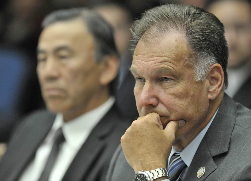 Tony Rackauckas, Orange County's elected district attorney, listens as witnesses testify in a preliminary hearing for the Kelly Thomas beating death case in Santa Ana, Calif., Monday, May 7, 2012. Officer Manuel Ramos, a 10-year-veteran of the department, is accused of second-degree murder and involuntary manslaughter and Cpl. Jay Cicinelli, who has worked in Fullerton since 1999, is charged with involuntary manslaughter and excessive force in the case. Both have pleaded not guilty. (AP Photo/The Orange County Register, Joshua Sudock, Pool)