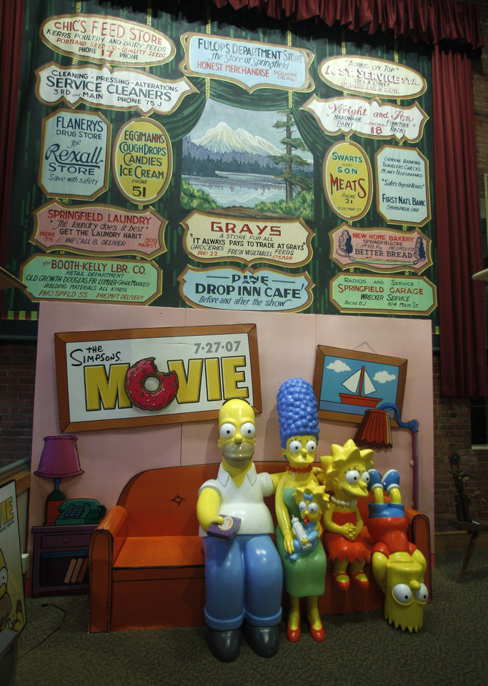 Photo -   The Simpsons Couch is shown on display at the Springfield Museum Tuesday, April 10, 2012, in Springfield, Ore. One of the best-kept secrets in television history has been revealed, with