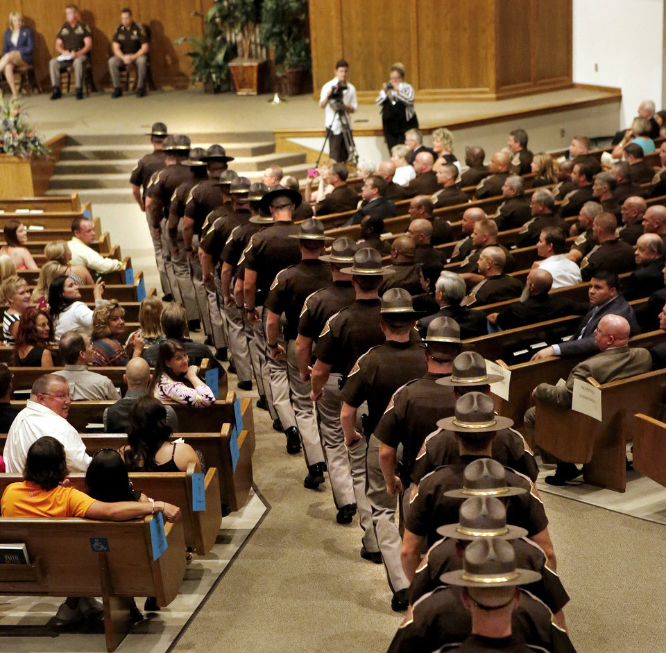 Photo - The Oklahoma Highway Patrol commissioned 40 new troopers during a ceremony Thursday afternoon at Memorial Road  Church of Christ in Oklahoma City.  Members of the graduating class march to their seats at the beginning of the ceremony. Photo  by Jim Beckel, The Oklahoman.  Jim Beckel