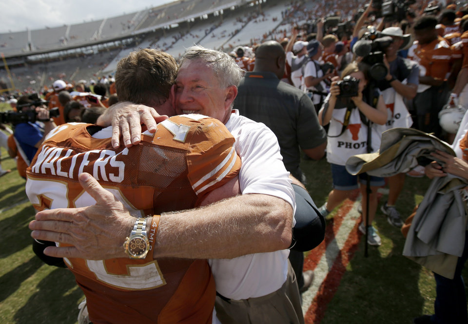 Texas coach Mack brown hugs UT's Mason Walters (72) after the Red River Rivalry college football game between the University of Oklahoma Sooners and the University of Texas Longhorns at the Cotton Bowl Stadium in Dallas, Saturday, Oct. 12, 2013. Texas won 36-20. Photo by Bryan Terry, The Oklahoman