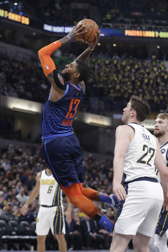 Photo - Oklahoma City Thunder's Paul George (13) goes up for a dunk against Indiana Pacers' T.J. Leaf (22) during the first half of an NBA basketball game, Thursday, March 14, 2019, in Indianapolis. (AP Photo/Darron Cummings)