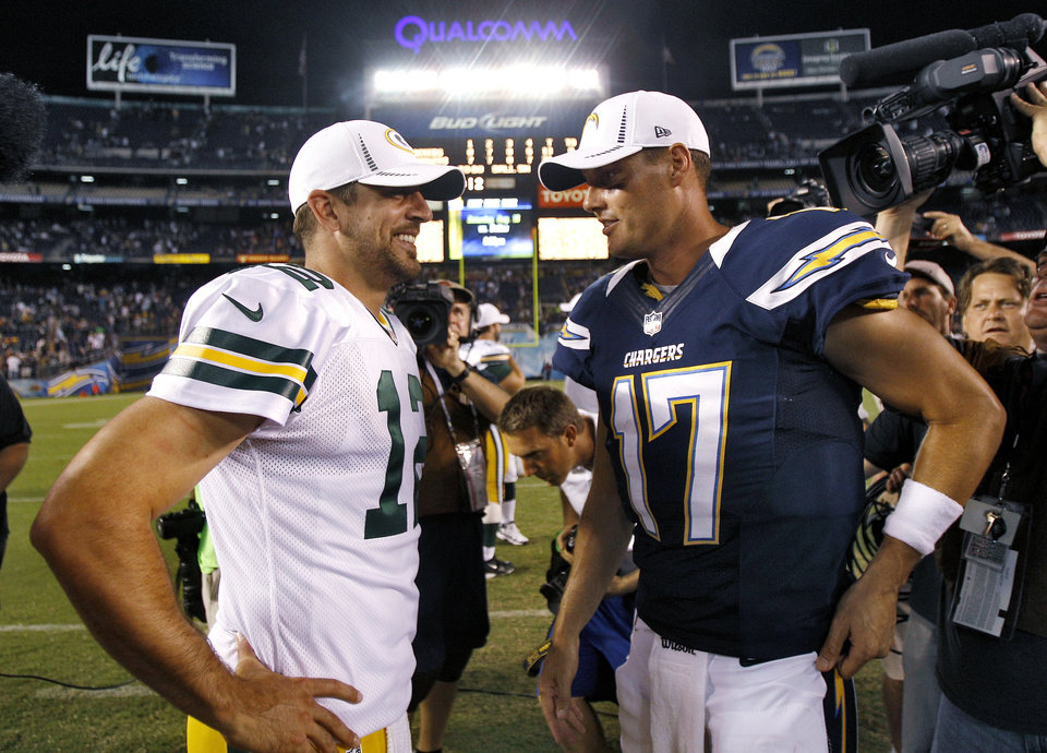 Green Bay Packers quarterback Aaron Rodgers (12) and San Diego Chargers quarterback Philip Rivers (17) meet after an NFL preseason football game Thursday, Aug. 9, 2012, in San Diego. The Chargers won 21-13. (AP Photo/Lenny Ignelzi) ORG XMIT: CAMY136