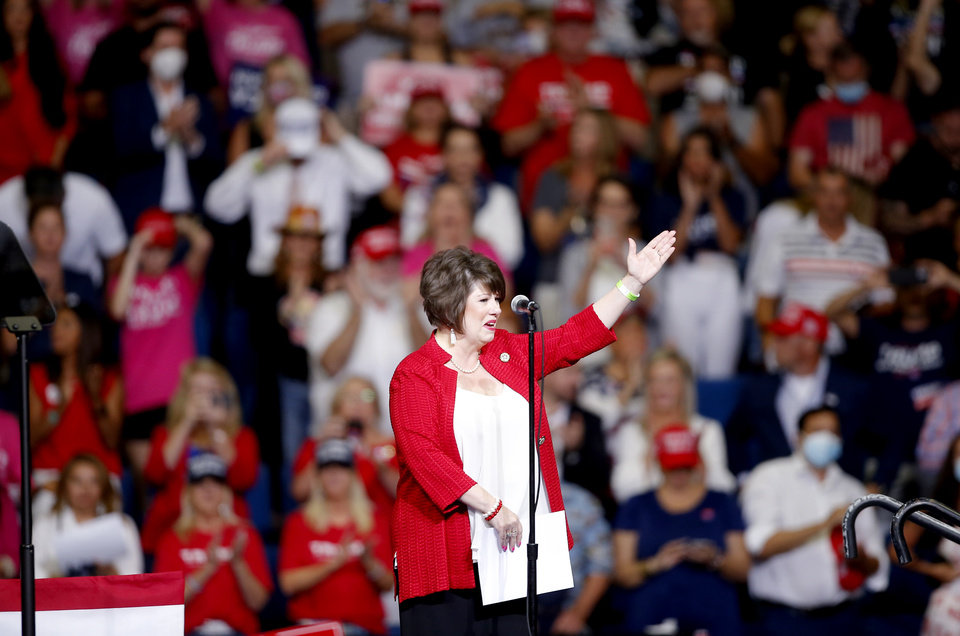 Photo - Cathy Costello sings the National Anthem before the President Donald Trump speaks during a rally at the BOK Center in Tulsa, Okla., Saturday, June 20, 2020. [Sarah Phipps/The Oklahoman]