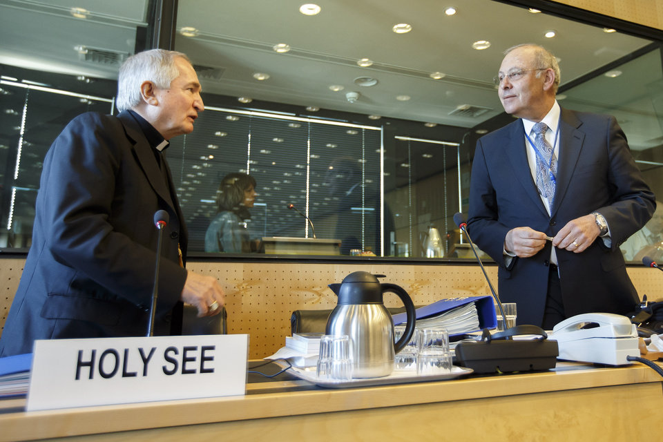 Photo - Archbishop Silvano M. Tomasi, left, Apostolic Nuncio, Permanent Observer of the Holy See (Vatican) to the Office of the United Nations in Geneva, speaks with Claudio Grossmann, right, Chairperson of UN Committee against Torture, prior the UN torture committee hearing on the Vatican, at the headquarters of the office of the High Commissioner for Human Rights (OHCHR) in the Palais Wilson, in Geneva, Switzerland, Monday, May 5, 2014. The UN Committee Against Torture hears the Holy See for the first time to consider whether the church's handling of child sexual abuse complaints has violated its obligations against subjecting minors to torture and to hear the Vatican on its efforts to stamp out child sex abuse by priests. (AP Photo/Keystone, Salvatore Di Nolfi)