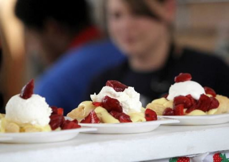 Dishes of Strawberries Newport get served up at the Strawberries Newport & Science Museum Oklahoma booth on International Food Row during the Festival of the Arts in downtown Oklahoma City, Wednesday, April 25, 2012. Photo by Nate Billings, The Oklahoman Archives