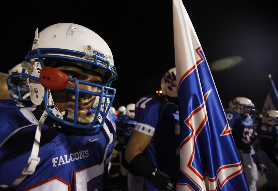 Millwood's Larry Seals and the rest of the Falcons prepare to take the field during the Class 2A State semifinal football game between Millwood High School and Kingfisher High School on Saturday, Dec. 5, 2009, in Yukon, Okla. 