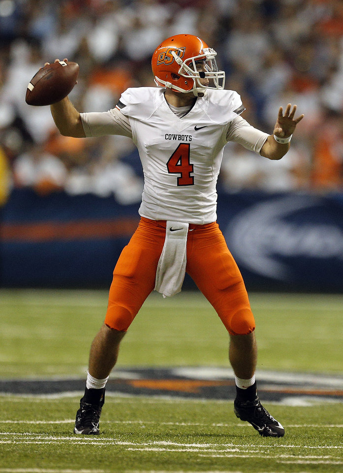 Photo - Oklahoma State's J.W. Walsh (4) throws a pass during the first half of a college football game between the University of Texas at San Antonio Roadrunners (UTSA) and the Oklahoma State University Cowboys (OSU) at the Alamodome in San Antonio, Saturday, Sept. 7, 2013.  Photo by Sarah Phipps, The Oklahoman