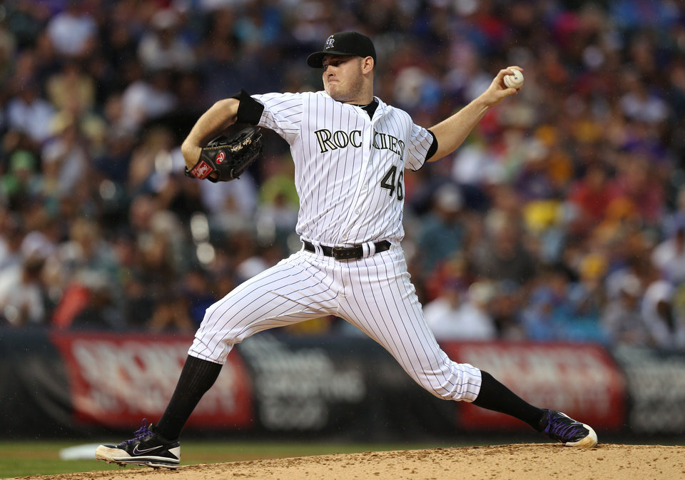 Photo - Colorado Rockies starting pitcher Tyler Matzek works throws to a Pittsburgh Pirates batter in the fourth inning of a baseball game in Denver on Saturday, July 26, 2014. (AP Photo/David Zalubowski)