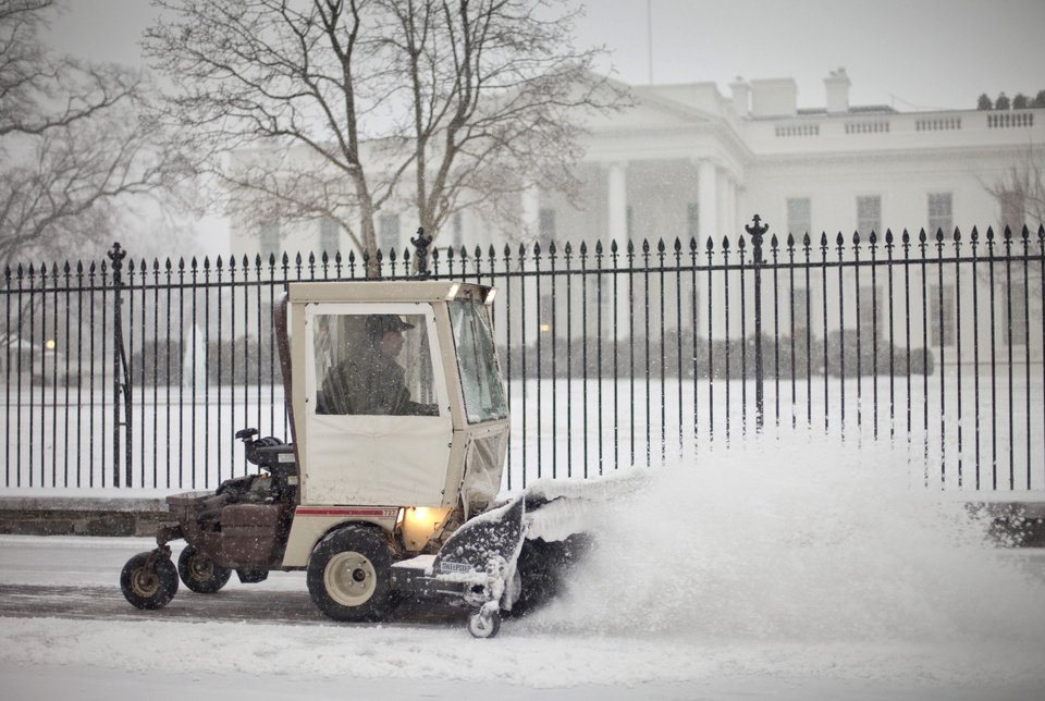 Photo - The sidewalk in front of the White House in Washington is cleared of snow, Monday, March 3, 2014. The National Weather Service has issued a Winter Storm Warning for the greater Washington Metropolitan region, prompting area schools and the federal government to close for the wintry weather. (AP Photo/Pablo Martinez Monsivais)