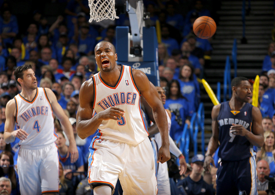 Photo - Oklahoma City's Serge Ibaka (9) reacts after getting fouled during Game 1 in the first round of the NBA playoffs between the Oklahoma City Thunder and the Memphis Grizzlies at Chesapeake Energy Arena in Oklahoma City, Saturday, April 19, 2014. Photo by Sarah Phipps, The Oklahoman