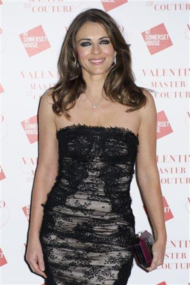 Elizabeth Hurley arrives for the Valentino Master of Couture Party on Wednesday, Nov. 28, 2012, in London. (Photo by Jonathan Short/Invision/AP)