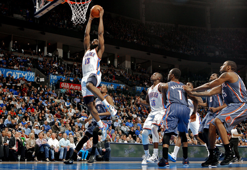 Oklahoma City Thunder's James Harden (13) scores during the second half of the NBA basketball game as the Oklahoma City Thunder defeat the Charlotte Bobcats at 122-95 at the Chesapeake Energy Arena in Oklahoma City, Saturday, March 10, 2012. Photo by Steve Sisney, The Oklahoman