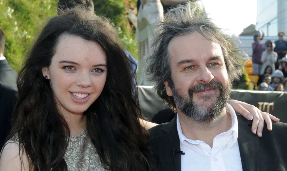 Director Peter Jackson, right, poses with his daughter Katie on the red carpet at the premiere of his new film