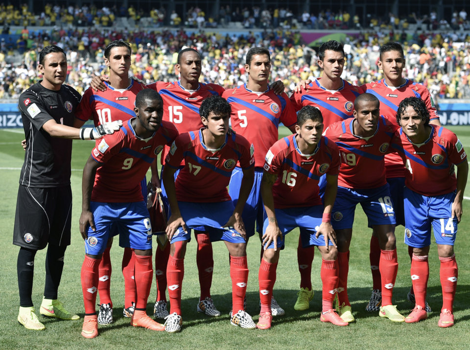 Photo - Costa Rica players pose for pictures before  the group D World Cup soccer match between Costa Rica and England at the Mineirao Stadium in Belo Horizonte, Brazil, Tuesday, June 24, 2014. (AP Photo/Martin Meissner)