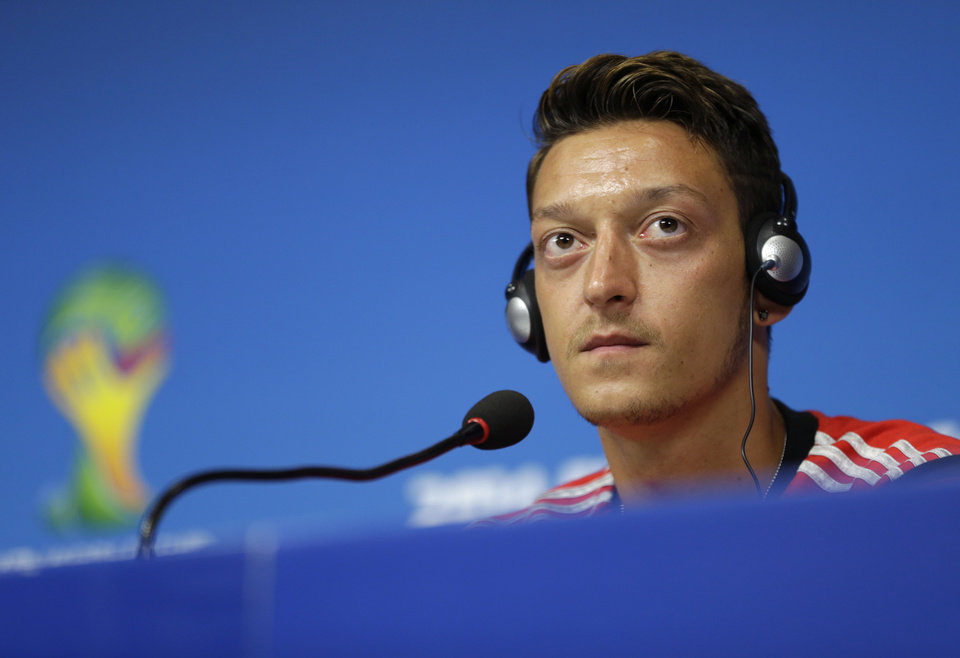 Photo - Germany's Mesut Ozil attends a press conference prior to a training session in Recife, Brazil, Wednesday, June 25, 2014. Germany will play the United States in group G of the 2014 soccer World Cup on June 26. (AP Photo/Julio Cortez)