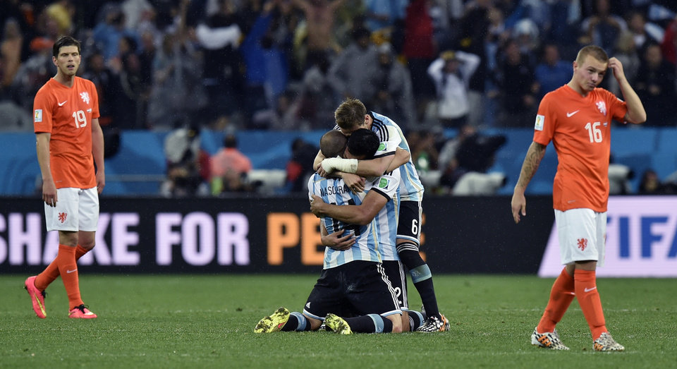 Photo - Argentina players celebrate after winning a shootout at the end of the World Cup semifinal soccer match between the Netherlands and Argentina at the Itaquerao Stadium in Sao Paulo Brazil, Wednesday, July 9, 2014. Argentina won 4-2 on penalties after the match ended 0-0 after extra time. (AP Photo/Martin Meissner)