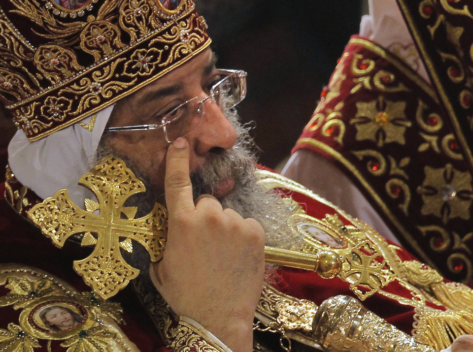 Pope Tawadros II, the 118th pope of the Coptic Church of Egypt, leads a midnight Mass on the eve of Egyptian Orthodox Christmas at St. Mark's Cathedral in Cairo, Egypt, late Sunday, Jan. 6, 2013. (AP Photo/Amr Nabil)