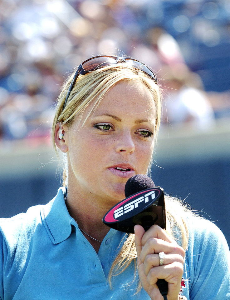 ESPN softball commentator and USA Softball pitcher Jennie Finch  doing a live segment from the field during the UCLA-LSU game. Photo by Jim Beckel, The Oklahoman