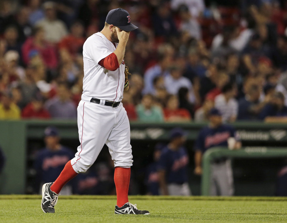 Photo - Boston Red Sox relief pitcher Alex Wilson walks back to the mound after giving up a two-RBI triple to Cleveland Indians' Drew Stubbs during the sixth inning of a baseball game at Fenway Park in Boston, Thursday, May 23, 2013. (AP Photo/Charles Krupa)