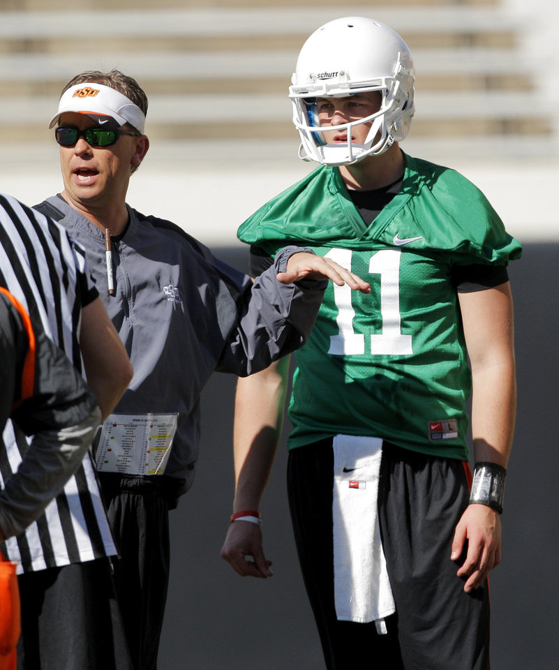 Photo - Wes Lunt (11) listens to offensive coordinator Todd Monken during OSU spring football practice at Boone Pickens Stadium on the campus of Oklahoma State University in Stillwater, Okla., Monday, March 12, 2012. Photo by Nate Billings, The Oklahoman