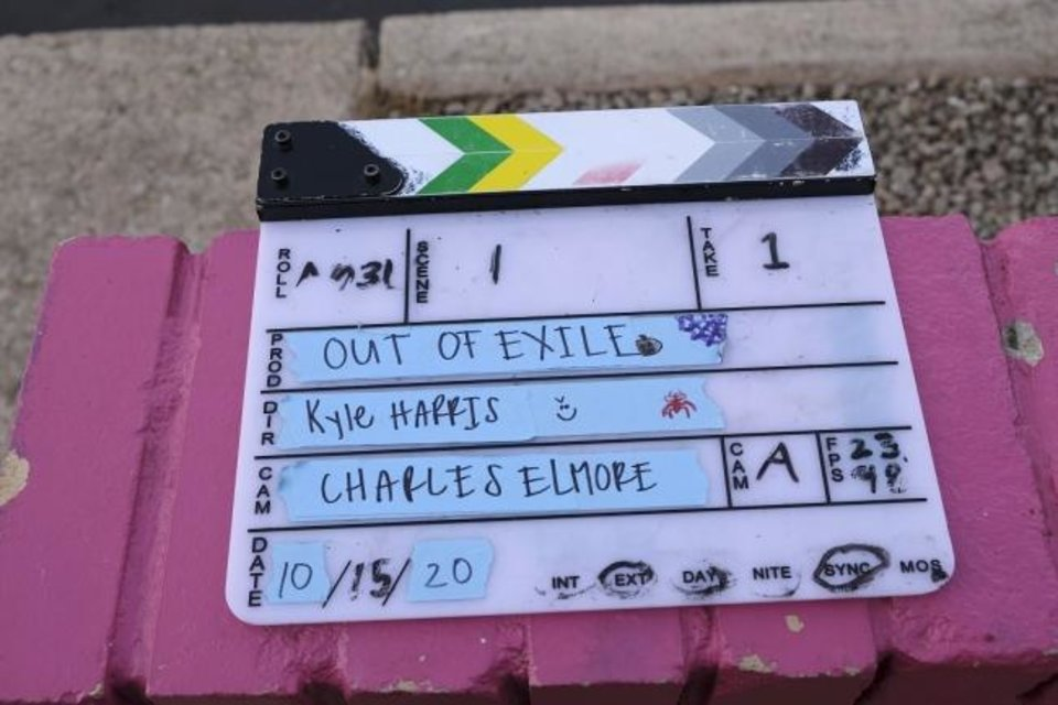 Photo -  A clapboard is ready for use on the set of the Oklahoma film