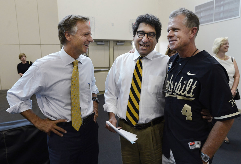 Photo - Tennessee Gov. Bill Haslem, left, Vanderbilt University Chancellor Nicholas S. Zeppos, center, and baseball coach Tim Corbin talk before the victory celebration for the team's first NCAA College World Series title, Thursday, June 26, 2014, in Nashville, Tenn. (AP Photo/Mark Zaleski)