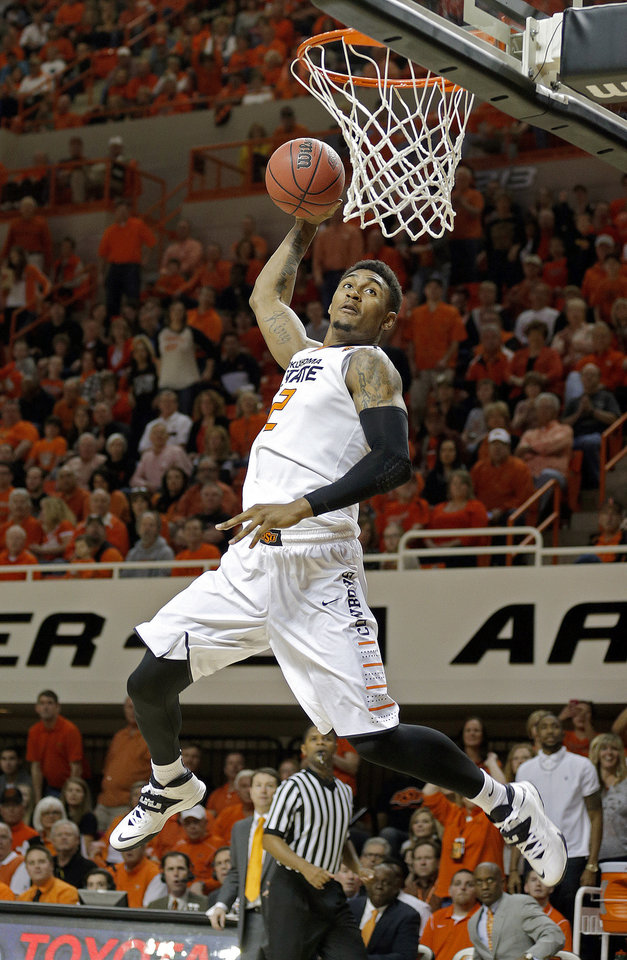 Photo - Oklahoma State's Le'Bryan Nash (2) goes up for a dunk during the men's college basketball game between Oklahoma State and Texas Tech at Gallagher-Iba Arena in Stillwater, Okla., Saturday, Feb. 22, 2014. OSU won 84-62. 