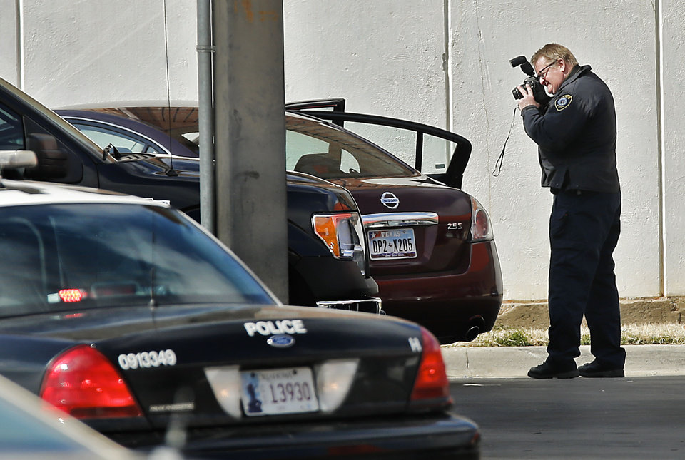 Crews investigate the scene of an officer-involved shooting that left one person dead Friday near Northwest Expressway and Wilshire Boulevard in Oklahoma City. Photos by Chris Landsberger, The Oklahoman