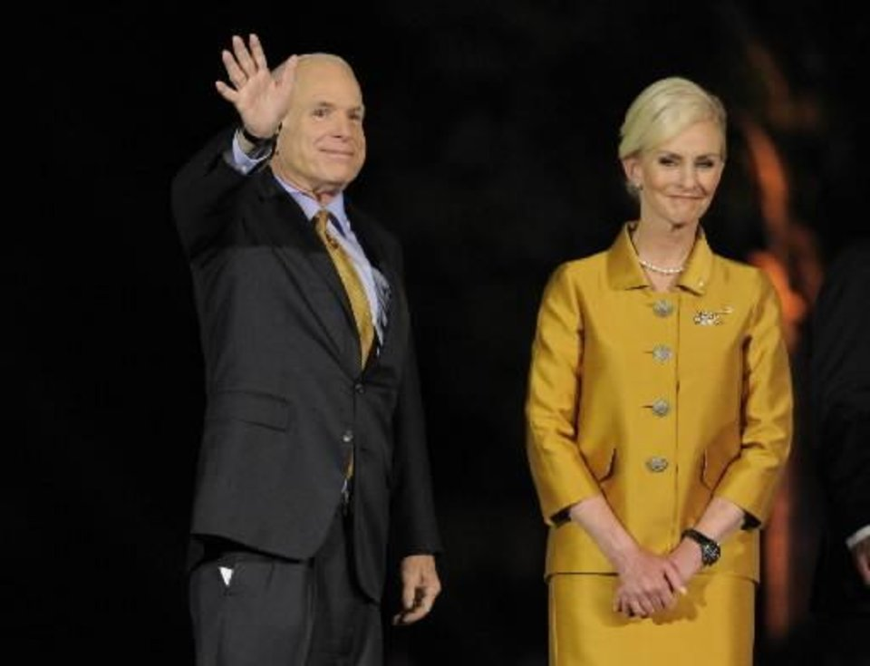 Sen. John McCain, R-Ariz., left, is joined by wife Cindy as he finishes his concession speech to a rally of supporters on election night in Phoenix, Tuesday, Nov. 4, 2008. (AP Photo/Chris Carlson)