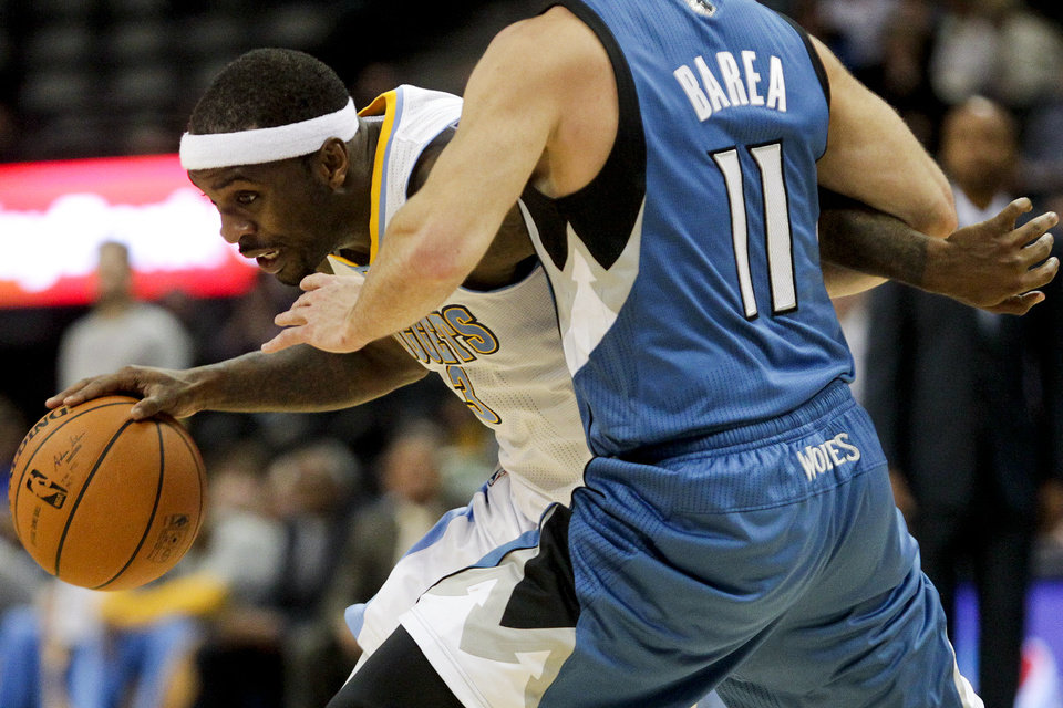 Photo - Denver Nuggets' Ty Lawson (3) drives around Minnesota Timberwolves' J.J. Barea (11) during the fourth quarter of an NBA basketball game Monday, March 3, 2014, in Denver. The Timberwolves won 132-128. (AP Photo/Barry Gutierrez)
