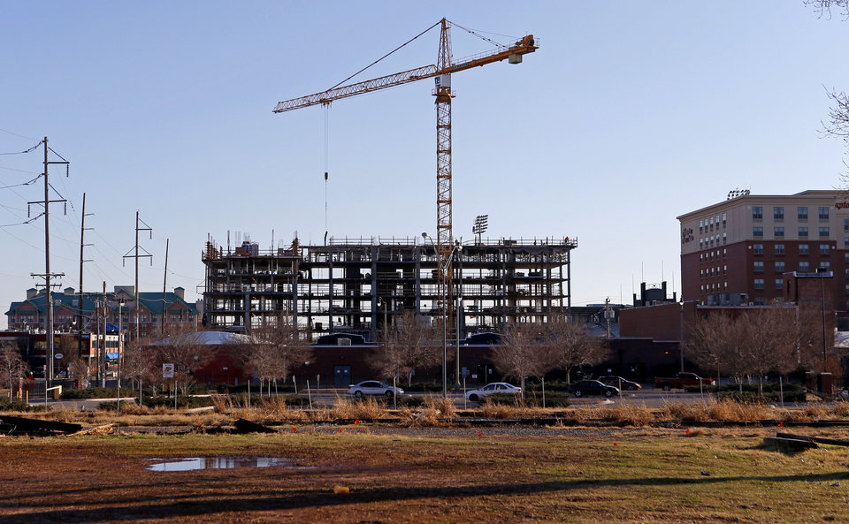 Photo - The new Hilton Garden Inn and Homeward Suites under construction near the corner of Sheridan and Joe Carter Ave in the Bricktown. The Hampton Inn is to the right and the Residence Inn is seen to the left.  Bryan Terry - THE OKLAHOMAN