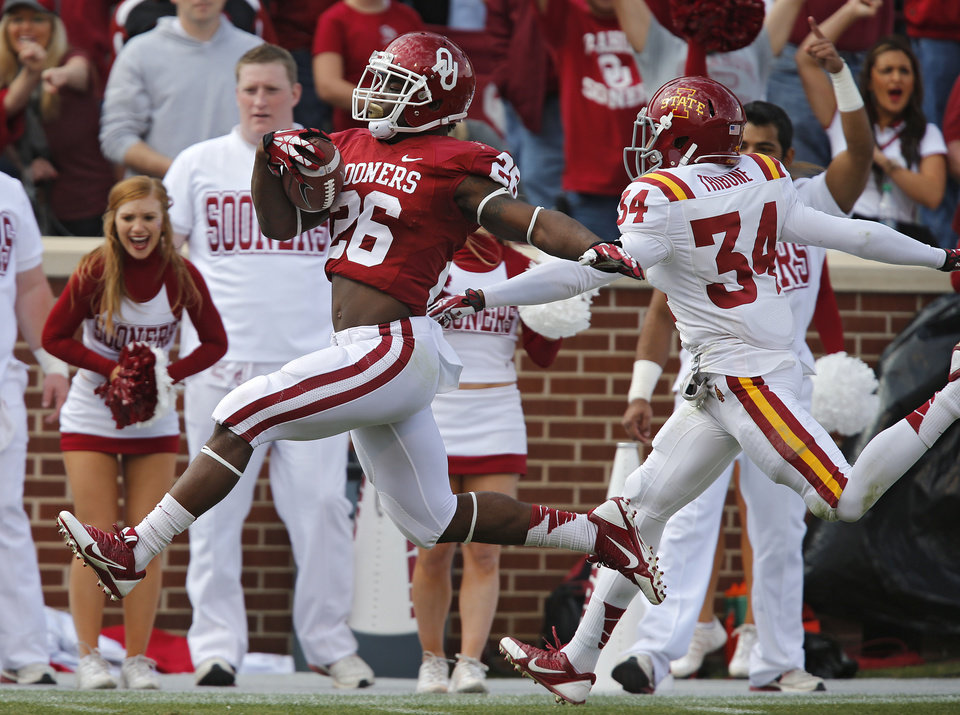 Oklahoma's Damien Williams (26) runs in for a touchdown in front of Iowa State's Nigel Tribune (34) during the college football game between the University of Oklahoma Sooners (OU) and the Iowa State University Cyclones (ISU) at Gaylord Family-Oklahoma Memorial Stadium in Norman, Okla. on Saturday, Nov. 16, 2013. Photo by Chris Landsberger, The Oklahoman