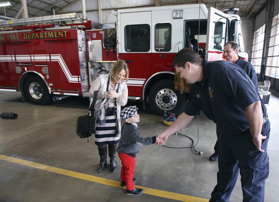ADVANCE FOR USE SATURDAY, DEC. 15 AND THEREAFTER - In this Dec. 7, 2012 photo, Alton firefighters greet 4-year-old Jentzen Felt, and his mother Stacy, in the truck bay at the Don Twichell Memorial Fire Station No. 1 in Alton, Ill. Jentzen, who has a rare form of cancer and underwent his fifth round of in-patient chemotherapy Nov. 30, was more than ready for his treat as firefighter for a day. (AP Photo/The Telegraph, John Badman) BELLEVILLE NEWS-DEMOCRAT OUT; ST. LOUIS POST DISPATCH OUT