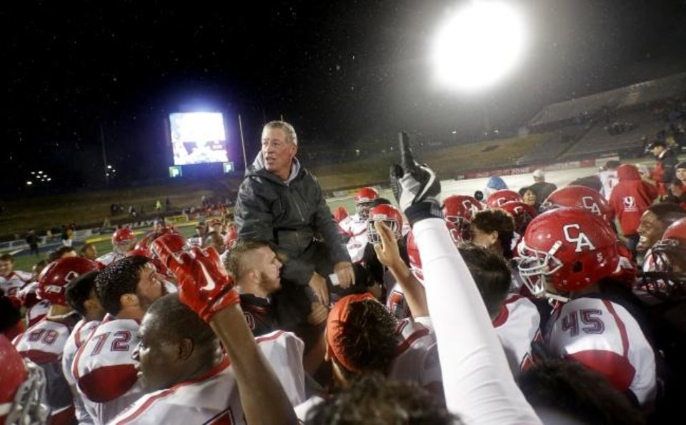 Photo -  Carl Albert players lift head coach Gary Rose on their shoulders as they celebrate the Class 5A state football championship win over Bishop McGuinness in 2016 at Wantland Stadium in Edmond. The Titans won 10 state titles under Rose..