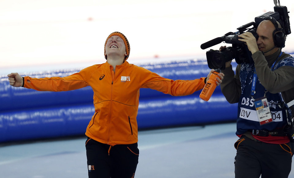 Photo - Gold medallist Jorien ter Mors of the Netherlands celebrates after the women's 1,500-meter speedskating race at the Adler Arena Skating Center during the 2014 Winter Olympics in Sochi, Russia, Sunday, Feb. 16, 2014. (AP Photo/Pavel Golovkin)