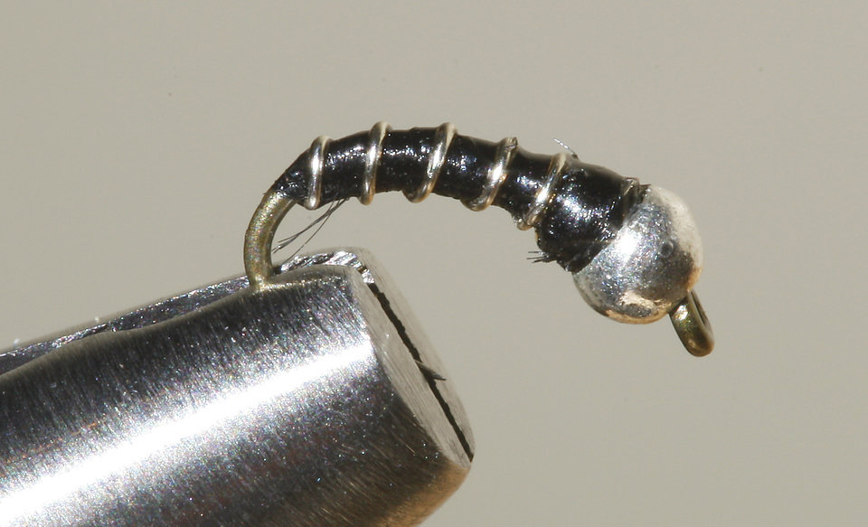 A Zebra Midge fly for fly fishing at Backwoods in Oklahoma City Thursday, Jan. 17, 2013.  Photo by Paul B. Southerland, The Oklahoman