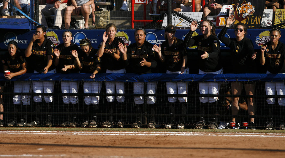 Arizona State players cheer from the dugout during a Women's College World Series game between Arizona State and LSU at ASA Hall of Fame Stadium in Oklahoma City, Saturday, June 2, 2012.  Photo by Garett Fisbeck, The Oklahoman