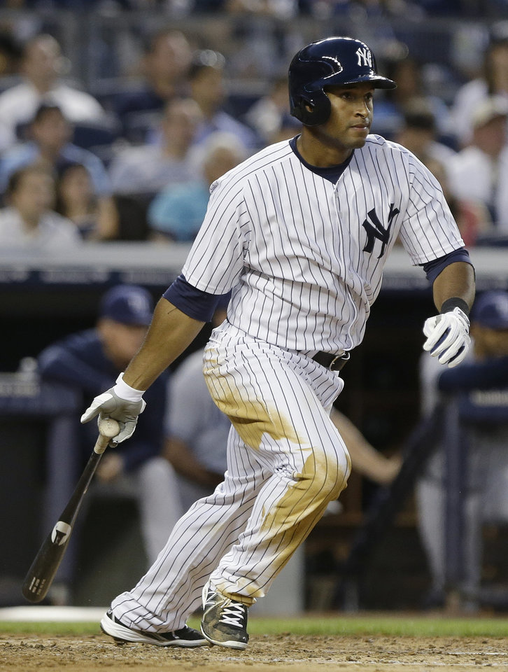 New York Yankees' Zoilo Almonte hits a single during the fourth inning of a baseball game against the Tampa Bay Rays, Friday, June 21, 2013, in New York. (AP Photo/Frank Franklin II)