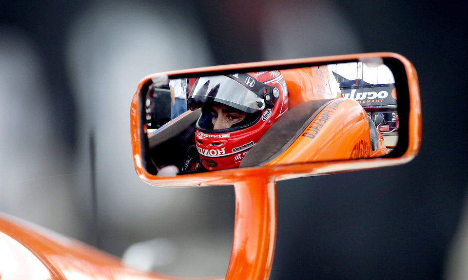 Photo - Simon Pagenaud, of France, sits in his car before the start of a practice session for the IndyCar Grand Prix of Houston auto race Friday, June 27, 2014, in Houston. (AP Photo/David J. Phillip)