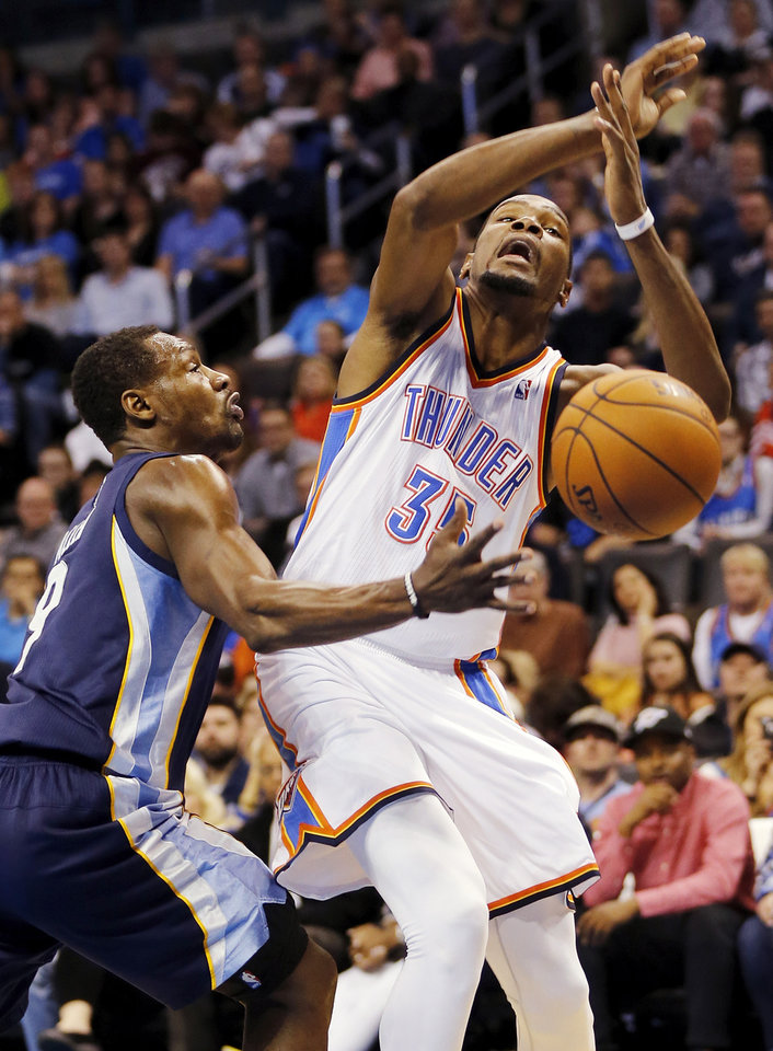 Photo - Oklahoma City's Kevin Durant (35) loses the ball as he is fouled by Memphis' Tony Allen (9) during an NBA basketball game between the Memphis Grizzlies and the Oklahoma City Thunder at Chesapeake Energy Arena in Oklahoma City, Friday, Feb. 28, 2014. Oklahoma City won, 113-107. Photo by Nate Billings, The Oklahoman
