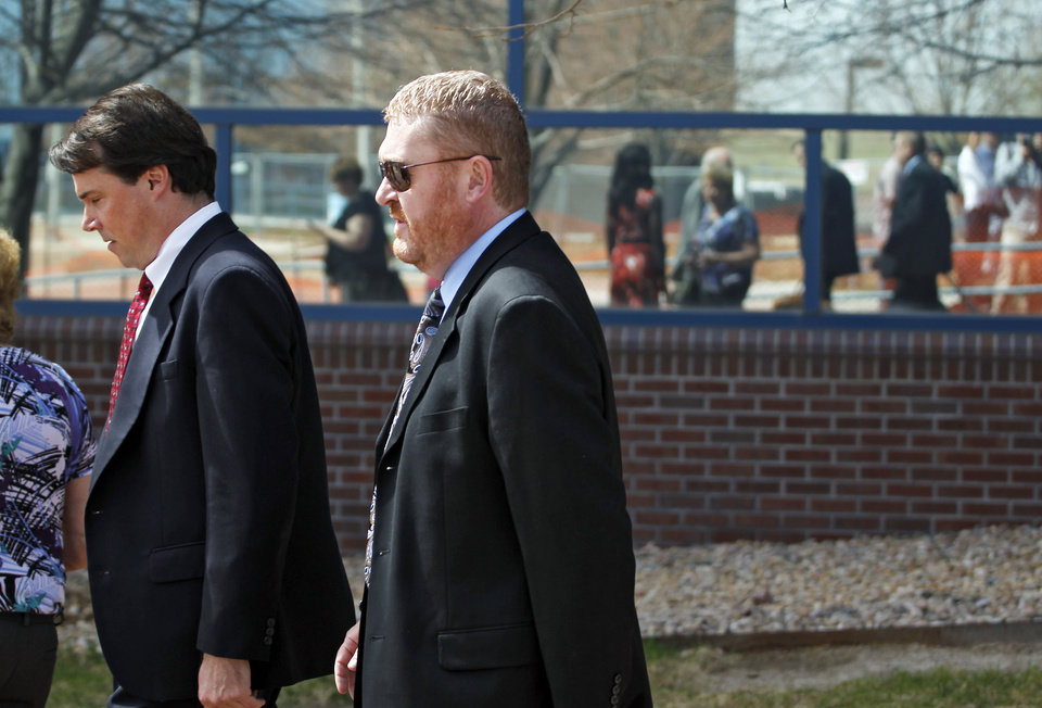 Photo - Defense attorney Daniel King, right, leaves the courthouse in Centennial, Colo., with a member of his team after a hearing where Aurora theater shooting suspect James Holmes asked to change his plea to not guilty by reason of insanity on Monday,  May 13, 2013. (AP Photo/Brennan Linsley)
